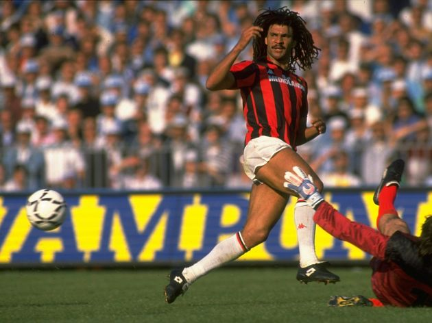 Ruud Gullit of AC Milan races to intercept the ball