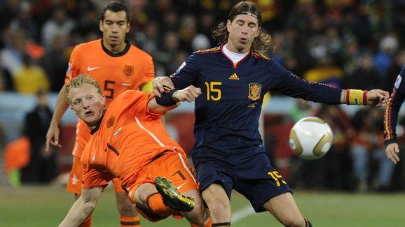 Spain's defender Sergio Ramos (R) fights