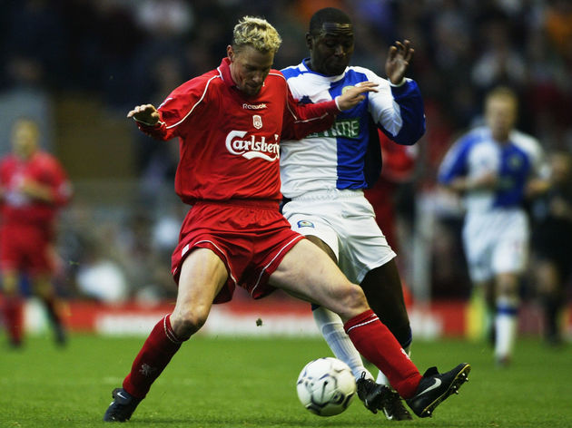 Stephane Henchoz of Liverpool and Andy Cole of Blackburn Rovers