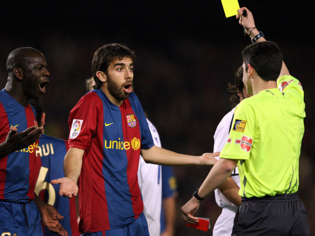 The referee Alberto Undiano gives a yell...