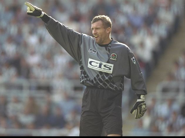 Tim Flowers of Blackburn orchestrates his defence