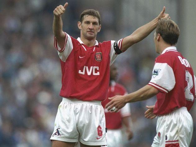 Tony Adams of Arsenal salutes the crowd