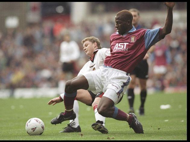 Ugo Ehiogu of Aston Villa (right) is tackled by Ole Gunnar Solskjaer