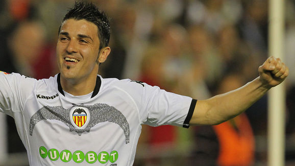 Valencia's forward David Villa celebrate