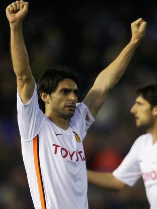 Valencia's Roberto Ayala celebrates afte...