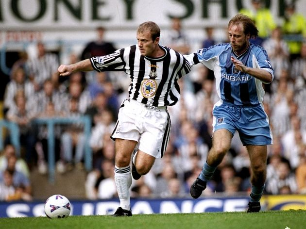 Alan Shearer of Newcastle is tackled by Jean Guy Walleme of Coventry