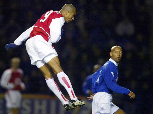 Arsenal's Gilberto da Silva (L) heads in