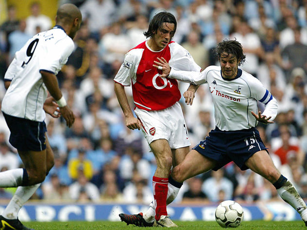 Arsenal's Robert Pires (C) is challenged
