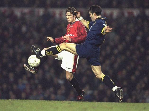 David Beckham of Manchester United (left) is challenged by Oylind Leonhardsen of Wimbledon