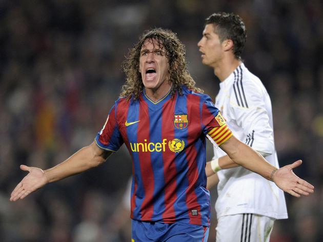 FC Barcelona's captain Carles Puyol reac