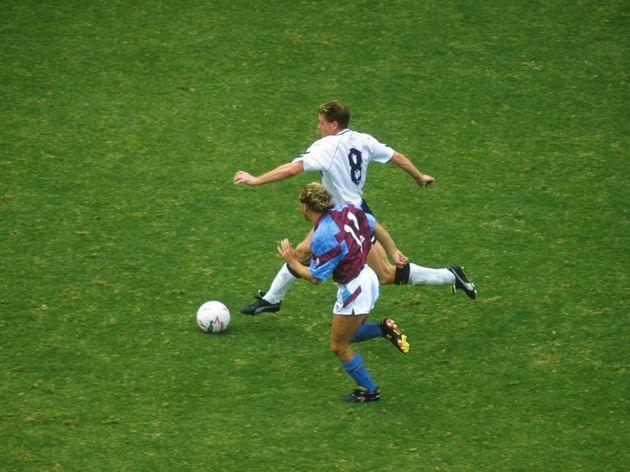 Paul Gascoigne of Tottenham Hotspur and Paul Birch of Aston Villa