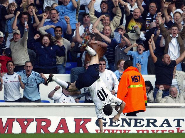 Robbie Keane of Tottenham cartwheels aft