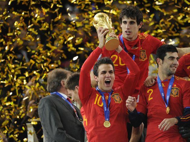 Spain's midfielder Cesc Fabregas holds t